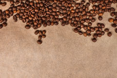 Coffee beans texture isolated. Background of coffee beans with space for writing lying on brown parchment Royalty Free Stock Photo