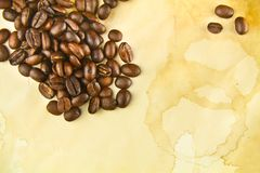 Coffee Beans on a Texture of Stained Paper Stock Photos