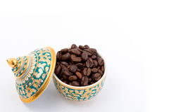 Coffee beans in Thai Ceramic. Porcelain on White background Stock Images
