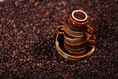 Coffee beans and three cups Royalty Free Stock Images