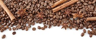 Coffee beans at the top with anise and cinnamon on white Royalty Free Stock Photos
