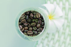 Coffee beans. Top view coffee beans in a glass Royalty Free Stock Photos