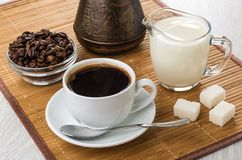 Coffee beans, turka, milk, sugar, cup with drink and spoon Royalty Free Stock Images