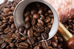 Coffee beans Turkish coffee pot. Turkish coffee pot coffee beans background Royalty Free Stock Image