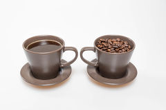 Coffee and beans in two mugs. Close up of coffee beans in a mug stock photo