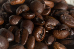 Coffee beans under strong directional light Royalty Free Stock Photos