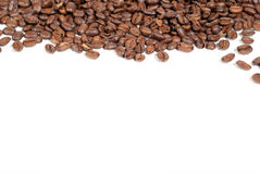 Coffee beans V1. Brown coffee beans with copy space on white background Stock Photos