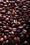Coffee beans vertical. Vertical texture of coffee beans. It can be used as background. Image feels moody Royalty Free Stock Image