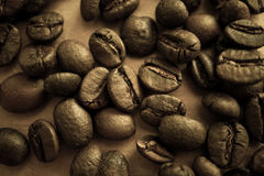 Coffee beans on vintage color paper background. Coffee beans on vintage color paper for background Stock Images