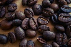 Coffee beans on vintage color paper background. Coffee beans on vintage color paper for background Royalty Free Stock Photography