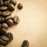 Coffee beans on vintage color paper background Stock Photos