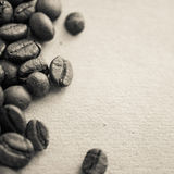 Coffee beans on vintage color paper background. Coffee beans on vintage color paper for background Royalty Free Stock Image