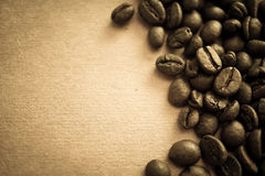 Coffee beans on vintage color paper background. Coffee beans on vintage color paper for background Royalty Free Stock Photo