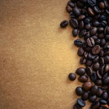 Coffee beans on vintage color paper background. Coffee beans on vintage color paper for background Stock Photos