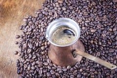Coffee beans, vintage copper coffee pot closeup, cezve or ibrik Stock Photo