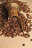 Coffee beans and vintage copper turkish coffee pot (cezve or ibrik) on the cloth sack. Roasted coffee beans and vintage copper turkish coffee pot (cezve or ibrik stock photos