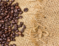 Coffee beans on vintage linen Royalty Free Stock Photos
