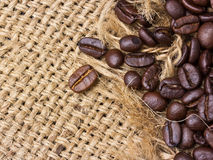 Coffee beans on vintage linen Stock Photo