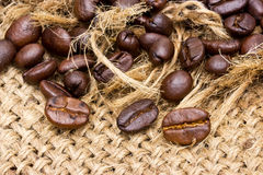 Coffee beans on vintage linen Royalty Free Stock Images