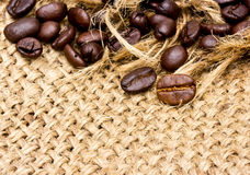 Coffee beans on vintage linen Stock Images