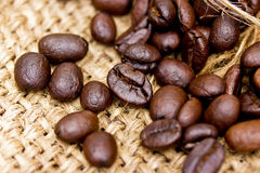 Coffee beans on vintage linen Royalty Free Stock Photography
