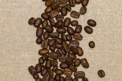 Coffee beans on vintage linen background Stock Image