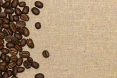 Coffee beans on vintage linen background Royalty Free Stock Photography