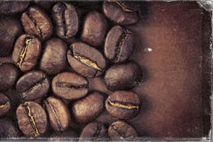 Coffee beans and vintage style, worn photo paper look image.  stock image