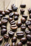Coffee beans on the vintage wood Stock Photo
