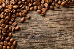 Coffee beans on vintage wooden background Stock Image