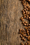 Coffee beans on vintage wooden background Stock Photo