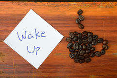 Coffee beans and wake up note Royalty Free Stock Image