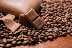 Coffee beans wallpaper with chocolate. Background stock photo