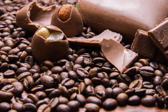 Coffee beans wallpaper with chocolate heart and candy. Background royalty free stock photography