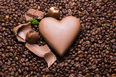 Coffee beans wallpaper with chocolate heart and candy. Background stock image