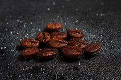 Coffee beans and water drop Stock Image
