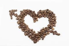 Coffee beans on a white background in the form of a heart with arrow isolated stock image