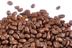 Coffee beans on white background.Fragrant fried coffee beans