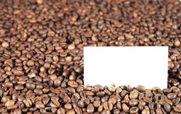 Coffee beans with white card Royalty Free Stock Photography