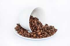 Coffee Beans on White Ceramic Saucer Stock Photos