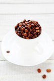 Coffee beans in a white cup Stock Photos