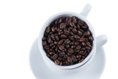Coffee beans in white cup. Coffee beans in cup on white background Royalty Free Stock Images