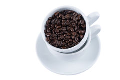 Coffee beans in white cup. Coffee beans in cup on white background Royalty Free Stock Image