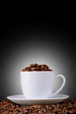 Coffee beans in a white cup on the background Royalty Free Stock Photo