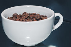 Coffee beans in white cup Stock Image