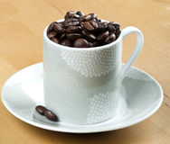 Coffee beans in white cup closeup Royalty Free Stock Images