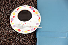 Coffee beans and white Cup in concept. Royalty Free Stock Image