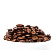 Coffee  beans in a white cup with copyspace for text. Coffee bac Royalty Free Stock Photography