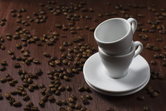 Coffee beans and white cup Stock Images