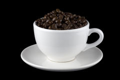 Coffee Beans in White Cup on Saucer Stock Image